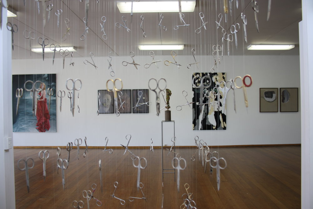 Pure Contemplation Without Knowledge 9 exhibition installation photograph, looking through Jane Braddock, Without words, 2017, scissors, nylon string, steel and wood, dimensions variable, photograph by Ron Nyisztor